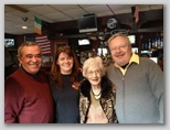 Olga with Dennis, Helton, and the bar owner Lisa